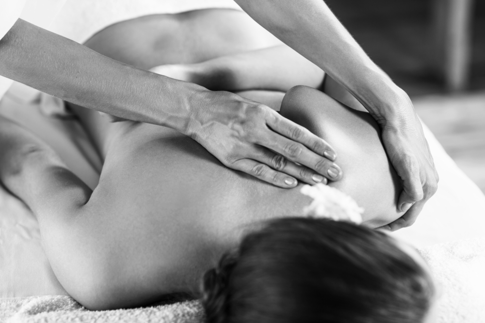 Image of person receiving a shoulder massage.